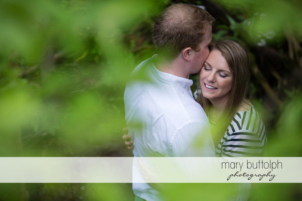 Couple express their love in the woods at Skaneateles Engagement