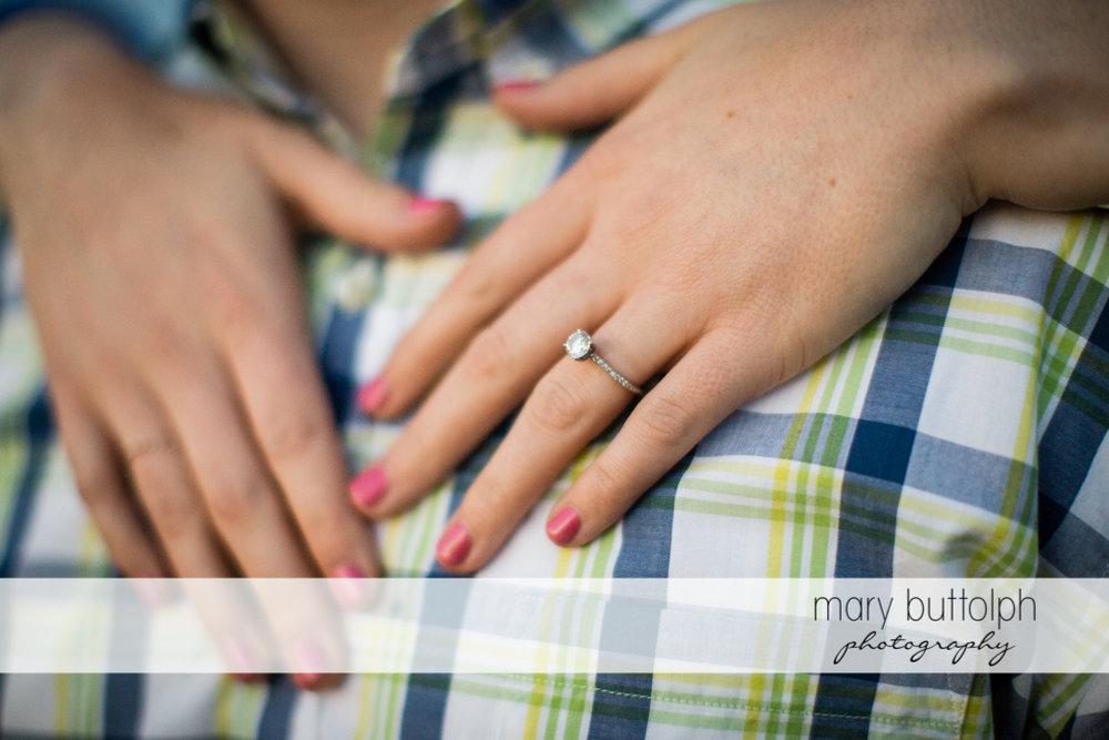 Close up shot of woman's engagement ring at Skaneateles Engagement