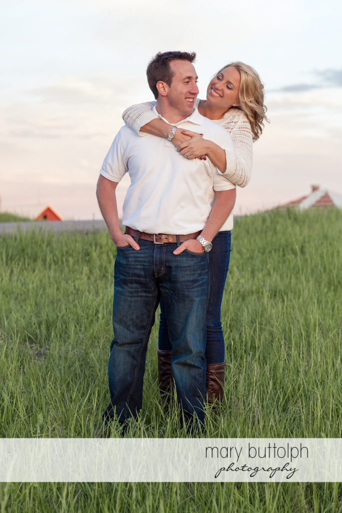 Couple pose in the field at Skaneateles Engagement