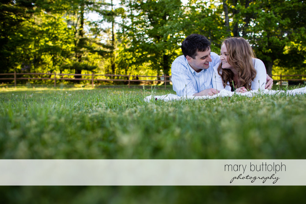 Couple relax on the lawn at Lourdes Camp Engagement