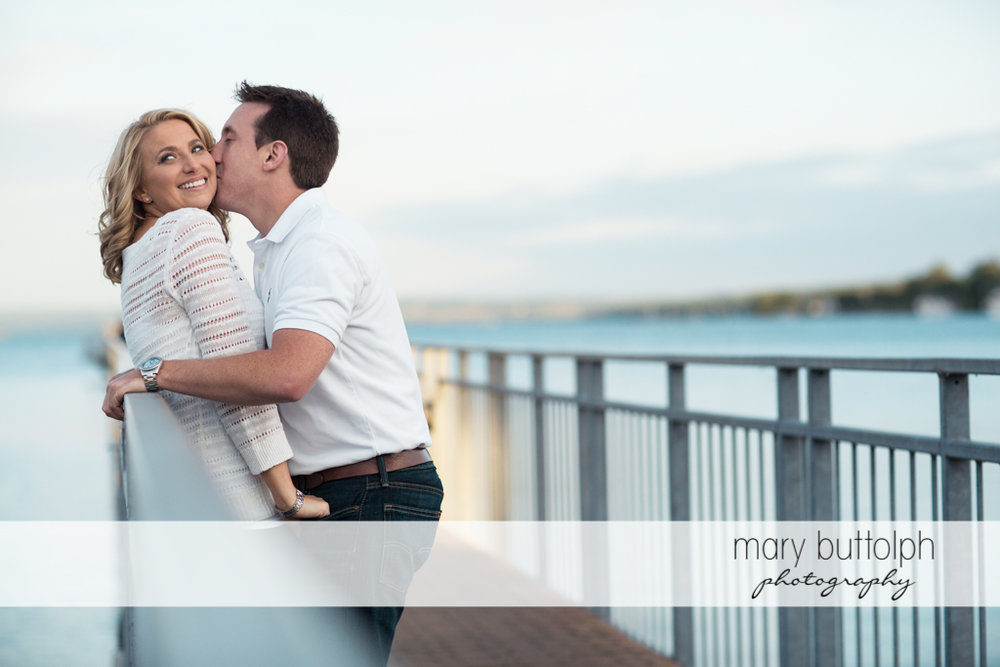 Couple relax by the lake at Skaneateles Engagement