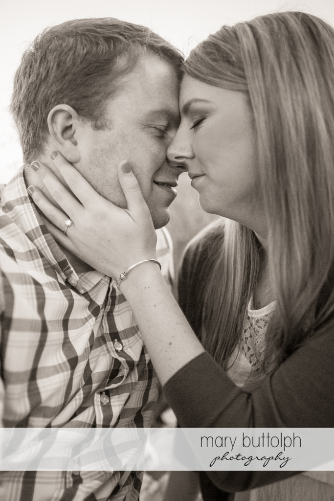 Couple show their affection in this dramatic black and white shot at Skaneateles Engagement