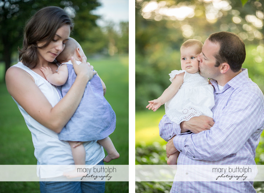 Couple take turns carrying their baby in the garden at Skaneateles Family