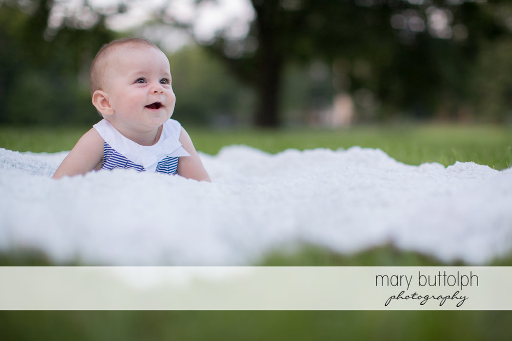 Baby sees something interesting in the garden at Skaneateles Family