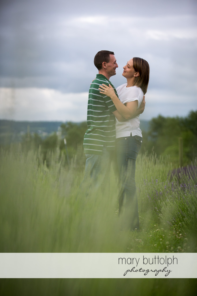 Couple embrace in the field at Lockwood Lavender Farm Engagement