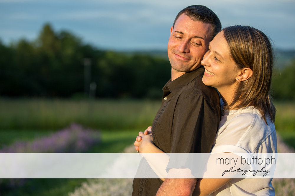 Couple share a good time in the field at Lockwood Lavender Farm Engagement