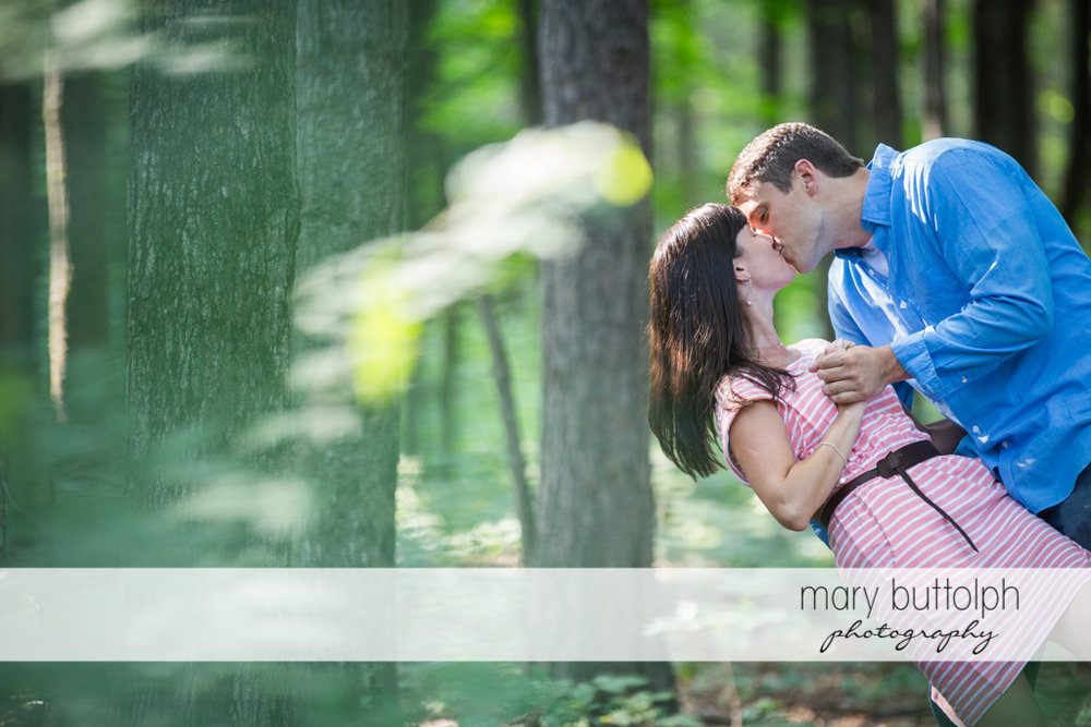 Couple show their romantic side in the woods at Skaneateles Lodge at Welch Allyn Engagement