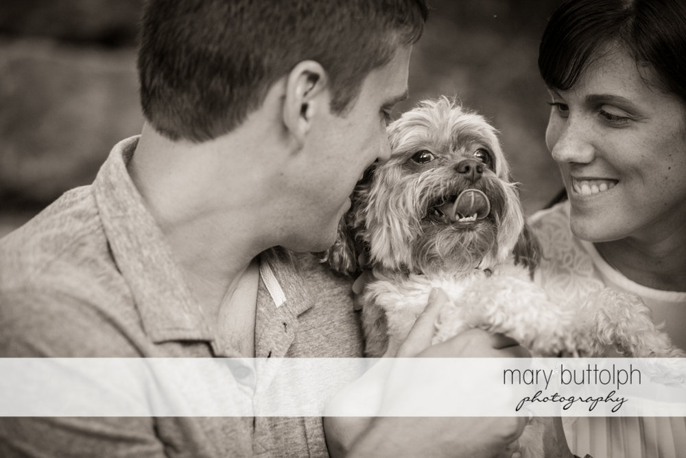 Couple spend time with their pet dog at Skaneateles Lodge at Welch Allyn Engagement