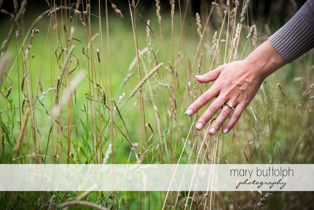 Woman shows her engagement ring in the field at Skaneateles Farm Engagement