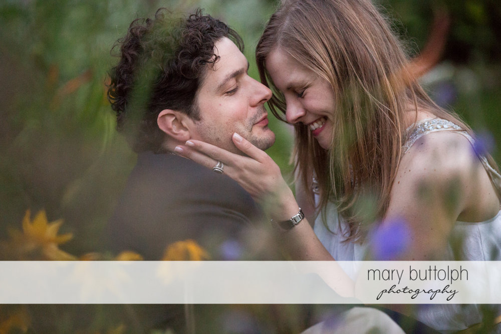 Couple relax in the garden at Skaneateles Engagement