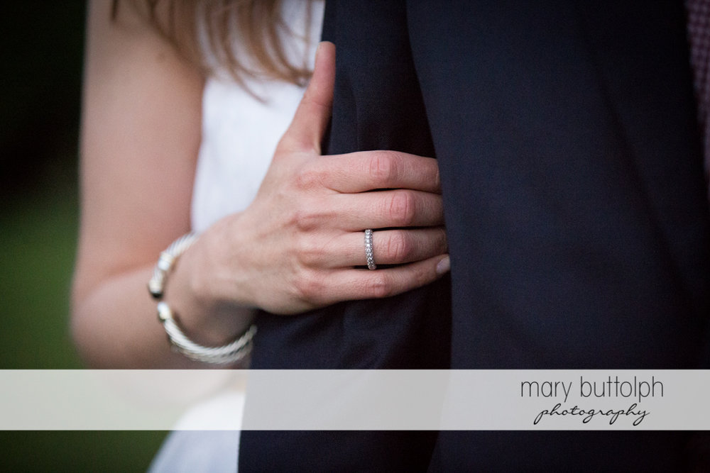 Woman's engagement ring stands out as she holds her companion's hand at Skaneateles Engagement