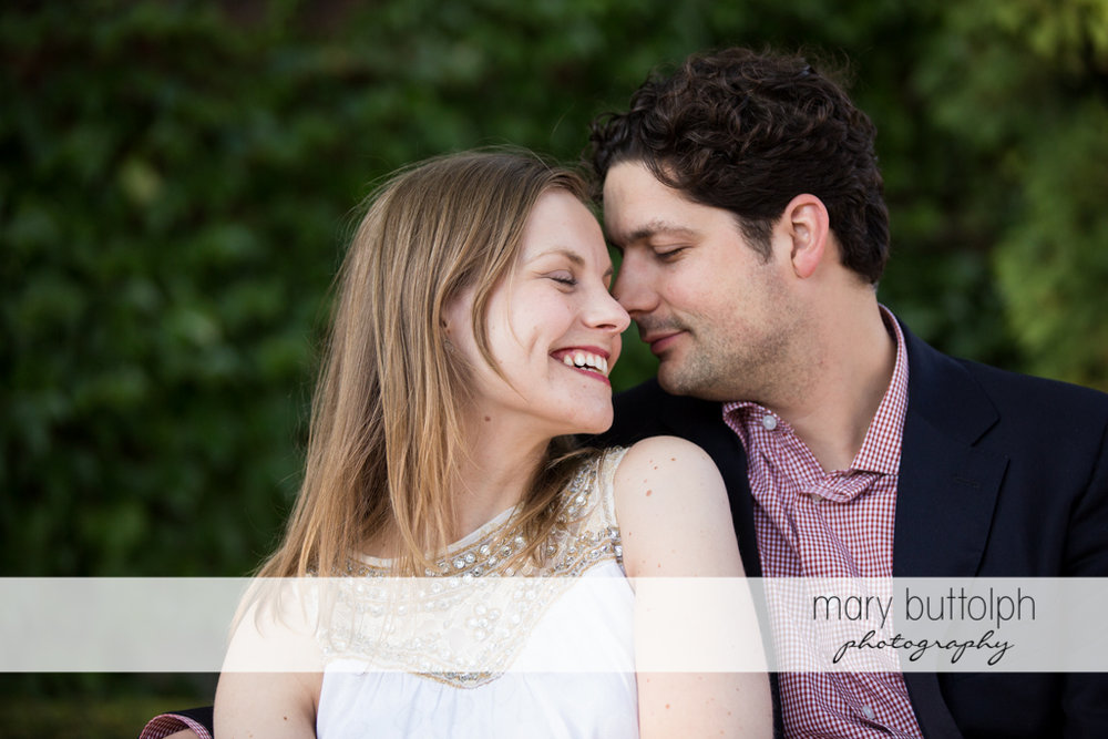 Couple in a romantic mood in the garden at Skaneateles Engagement