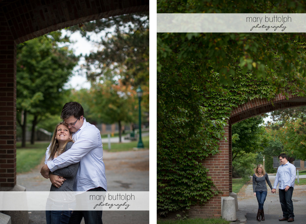 Couple share happy moments at the archway at SUNY Geneseo Engagement