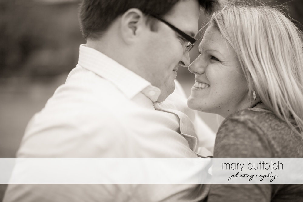 Couple keep close in this black and white shot at SUNY Geneseo Engagement