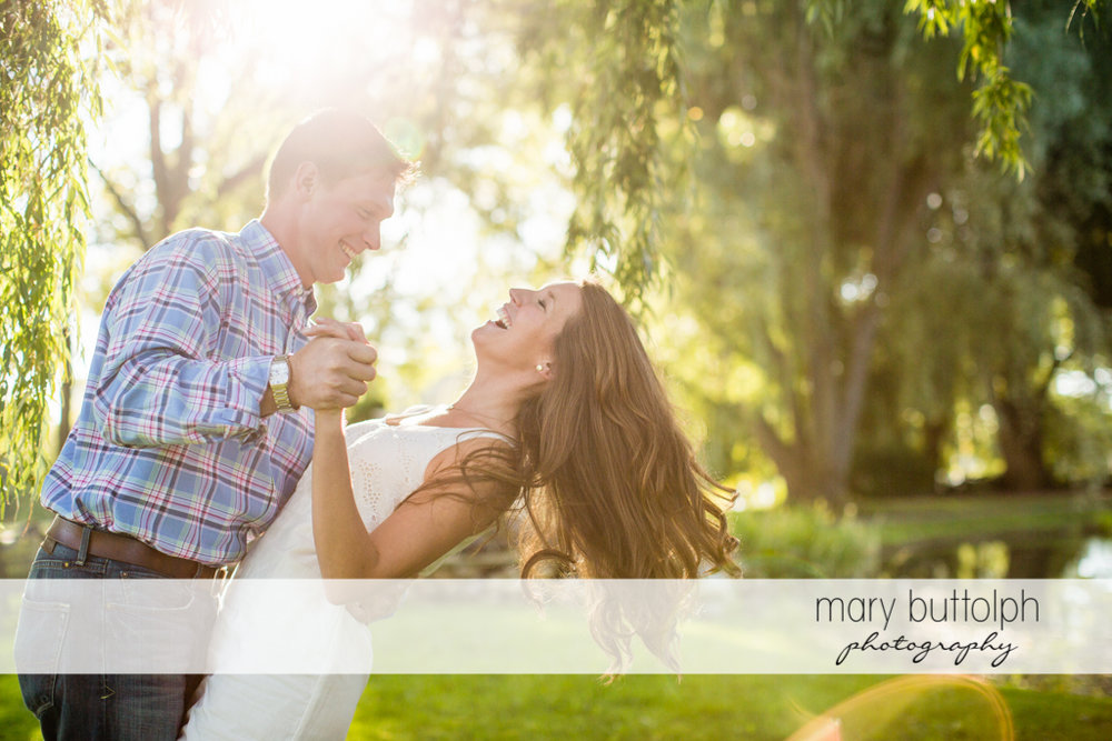 Couple dance in the woods at Aurora Engagement