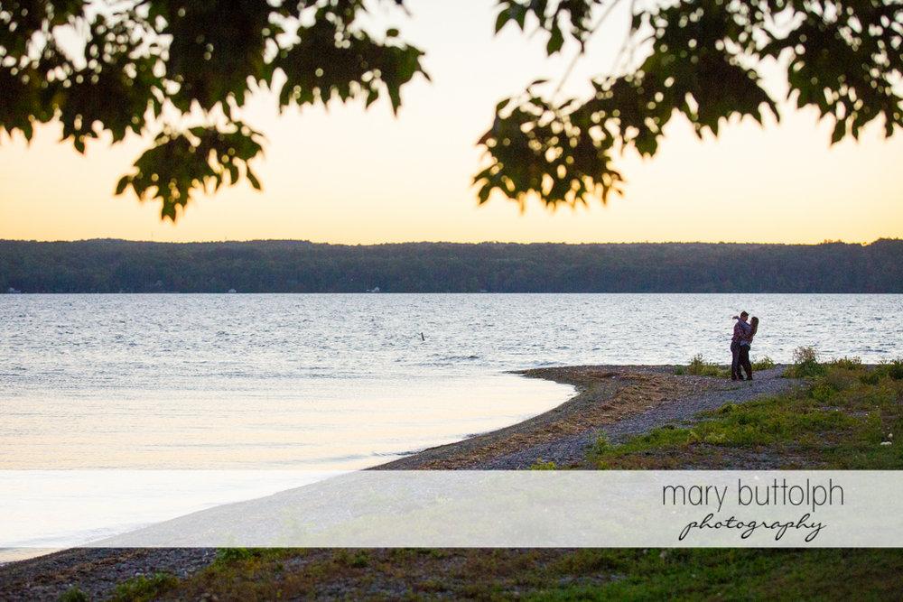 Couple pose near the lake at Aurora Engagement