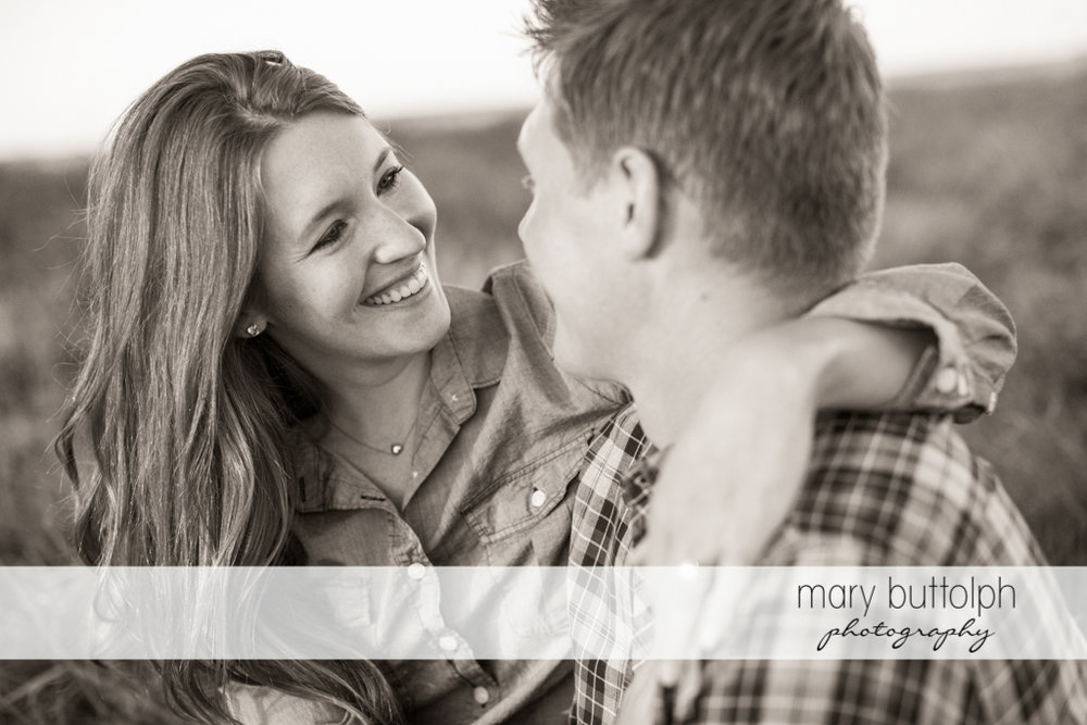 Couple share a light moment at Aurora Engagement
