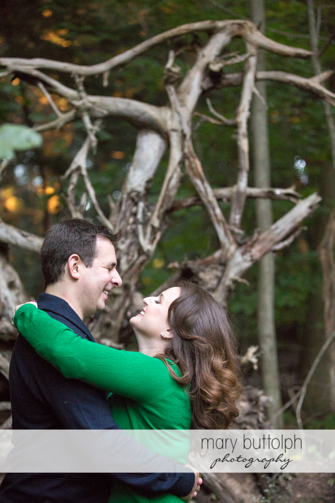 Couple spend time in the woods at Beaver Lake Nature Center Engagement