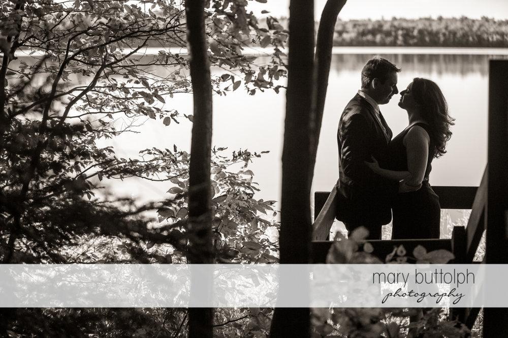 Couple pose near the lake at Beaver Lake Nature Center Engagement