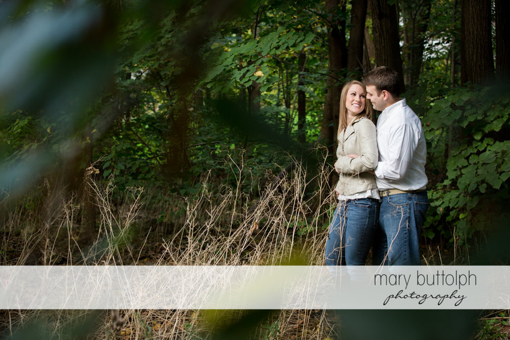 Couple take a break in the woods at Skaneateles Engagement