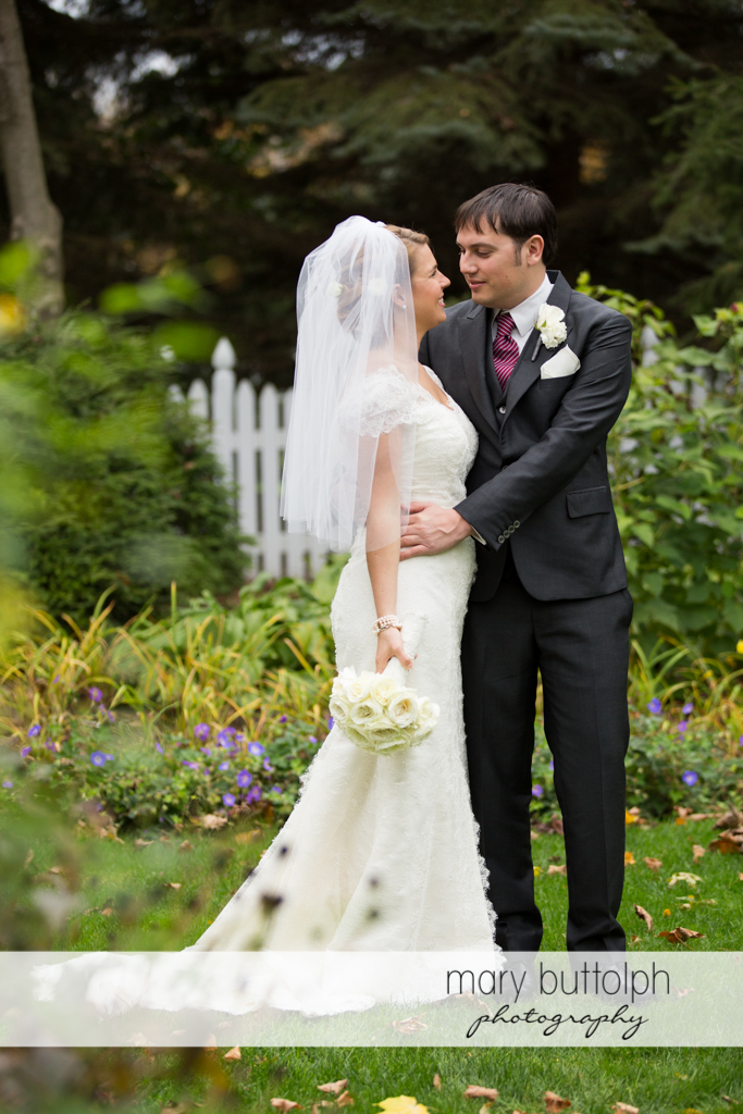 Couple share a tender moment in the garden at Traditions at the Links Wedding