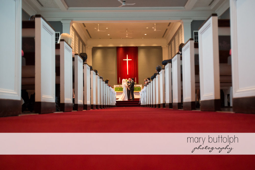 Long shot of the couple in front of the altar at Traditions at the Links Wedding