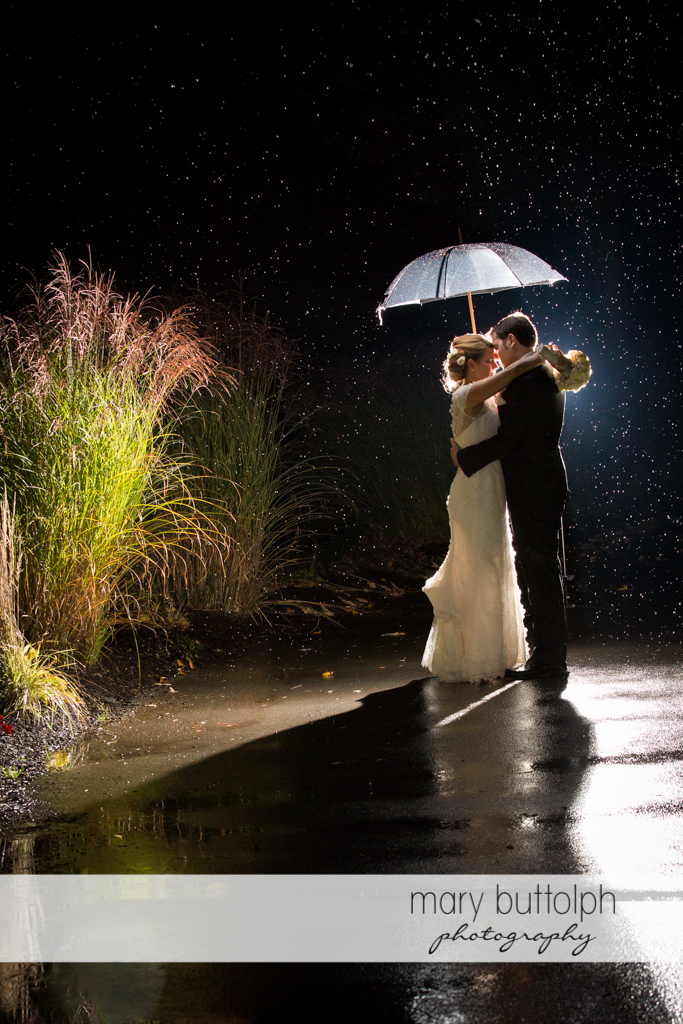 Rainy night for newly wed couple at Traditions at the Links Wedding
