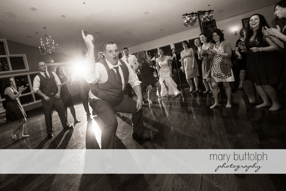 Gentleman having a great time on the dance floor at Traditions at the Links Wedding