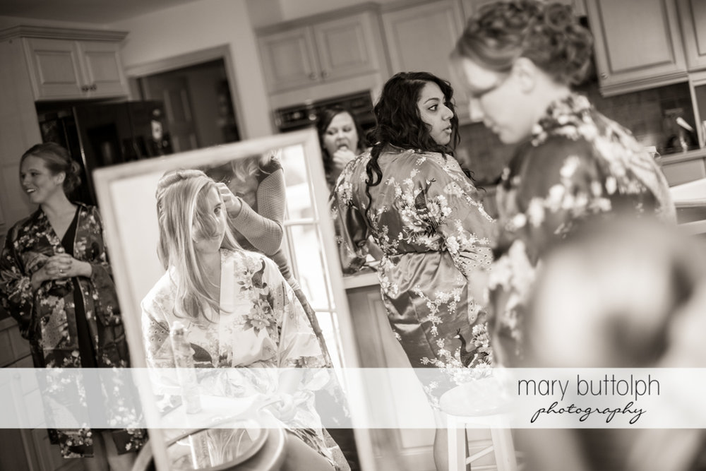 Bride's reflection in the mirror in her room at Traditions at the Links Wedding