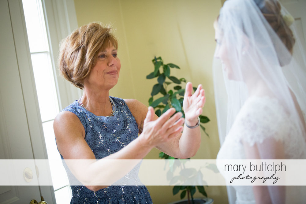 Bride's mom greets her daughter at Traditions at the Links Wedding