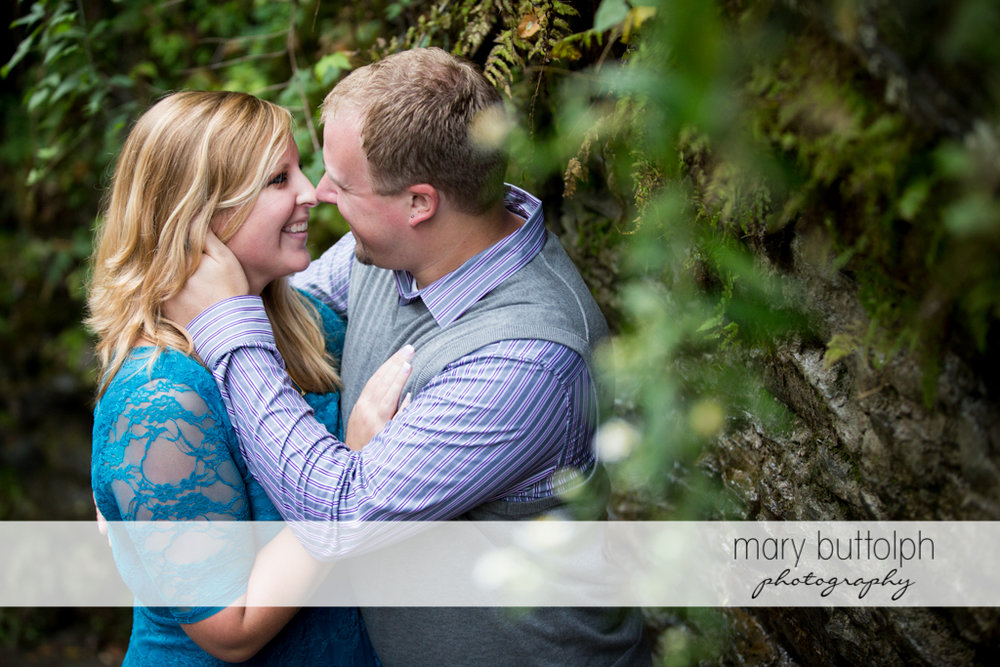 Couple rub noses in the woods at Watkins Glen Engagement