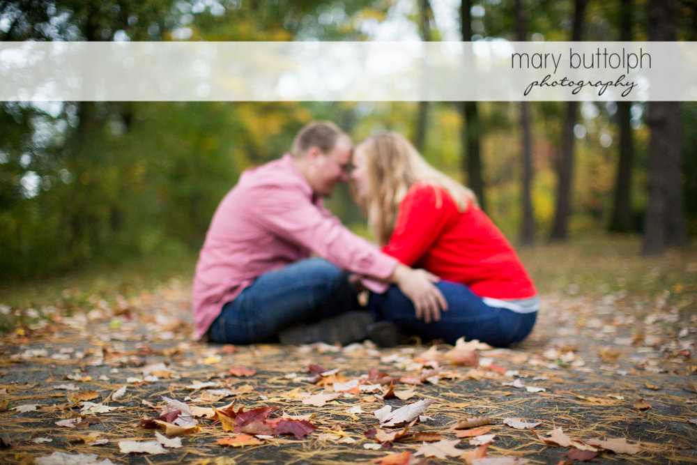 Couple sit in the middle of the road at Watkins Glen Engagement