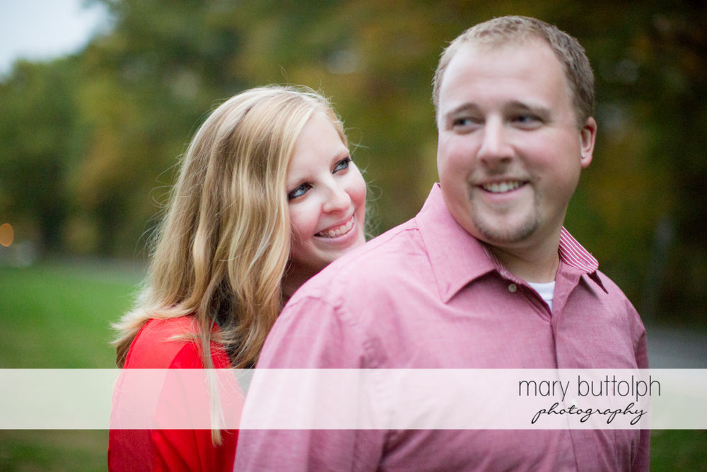 Close up shot of couple in the woods at Watkins Glen Engagement