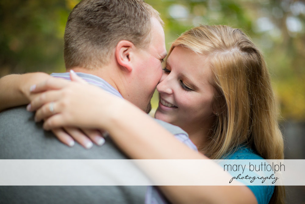 Couple embrace for the camera at Watkins Glen Engagement