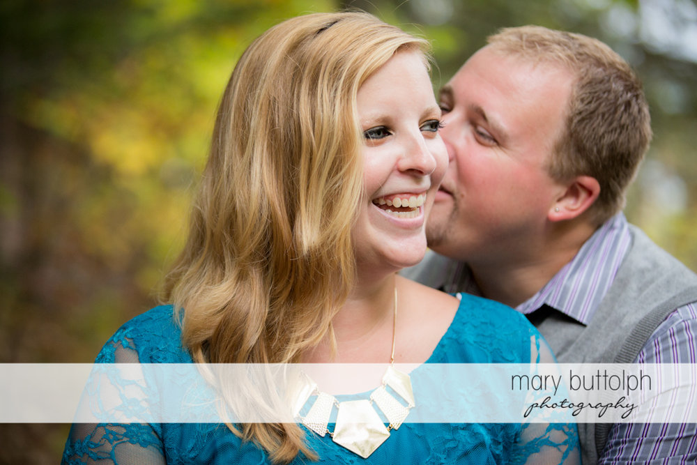 Couple share a happy moment at Watkins Glen Engagement