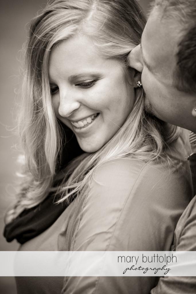 Man whispers something to the woman at Watkins Glen Engagement