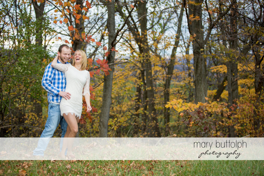 Couple have fun in the garden at Beak & Skiff Apple Orchards Engagement