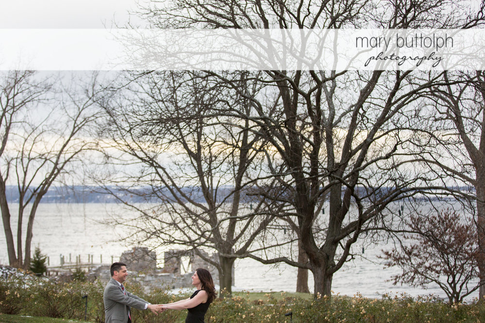 Couple in the garden overlooking the lake at the Aurora Inn Engagement