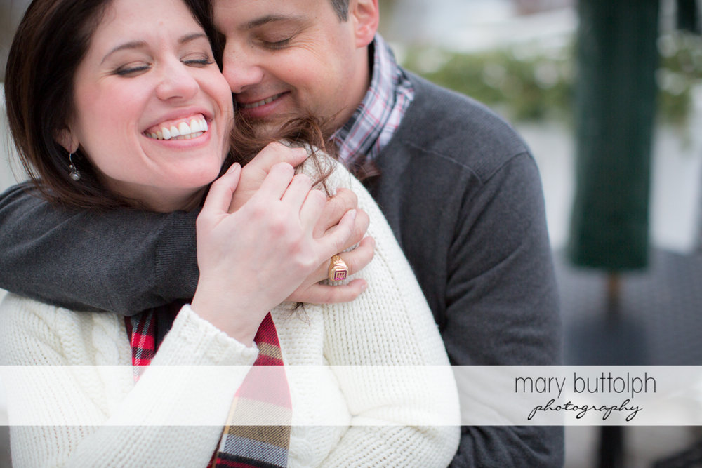 Couple share a tender moment at the Aurora Inn Engagement