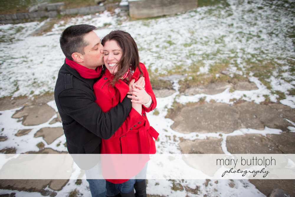 Couple show their affection in spite of the cold weather at the Aurora Inn Engagement