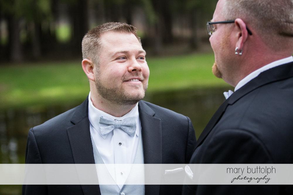Same sex couple face each other at Arrowhead Lodge Wedding