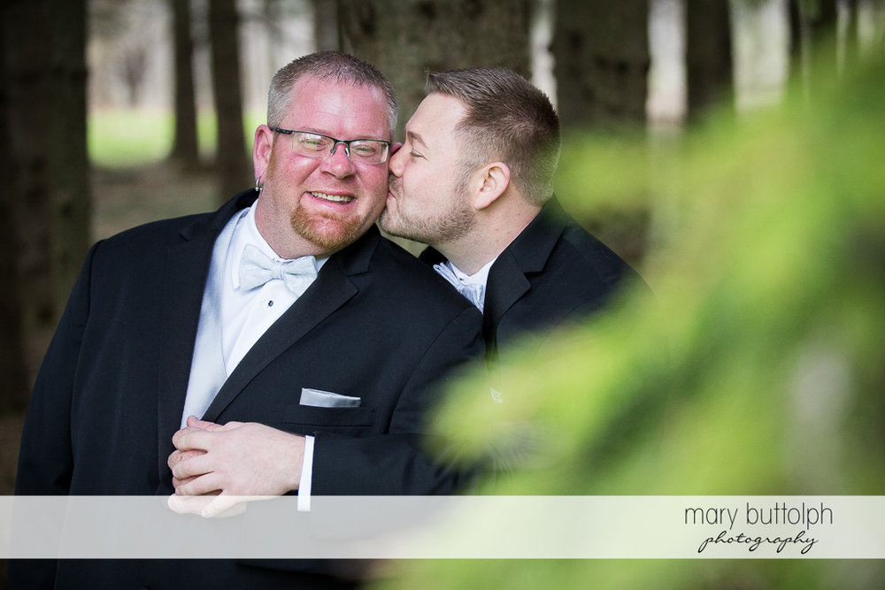 Same sex couple share a tender moment at Arrowhead Lodge Wedding
