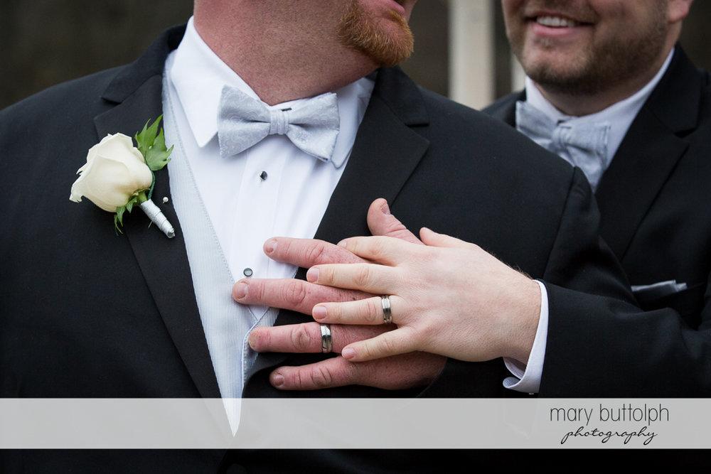 Same sex couple wear their wedding rings at Arrowhead Lodge Wedding