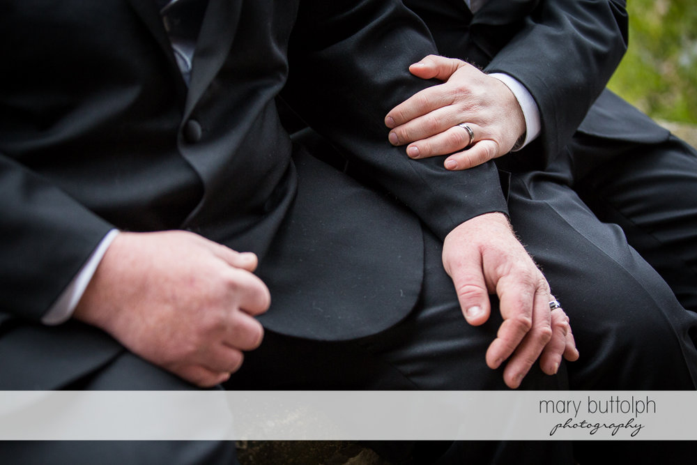Hands of same sex couple speak louder than words at Arrowhead Lodge Wedding