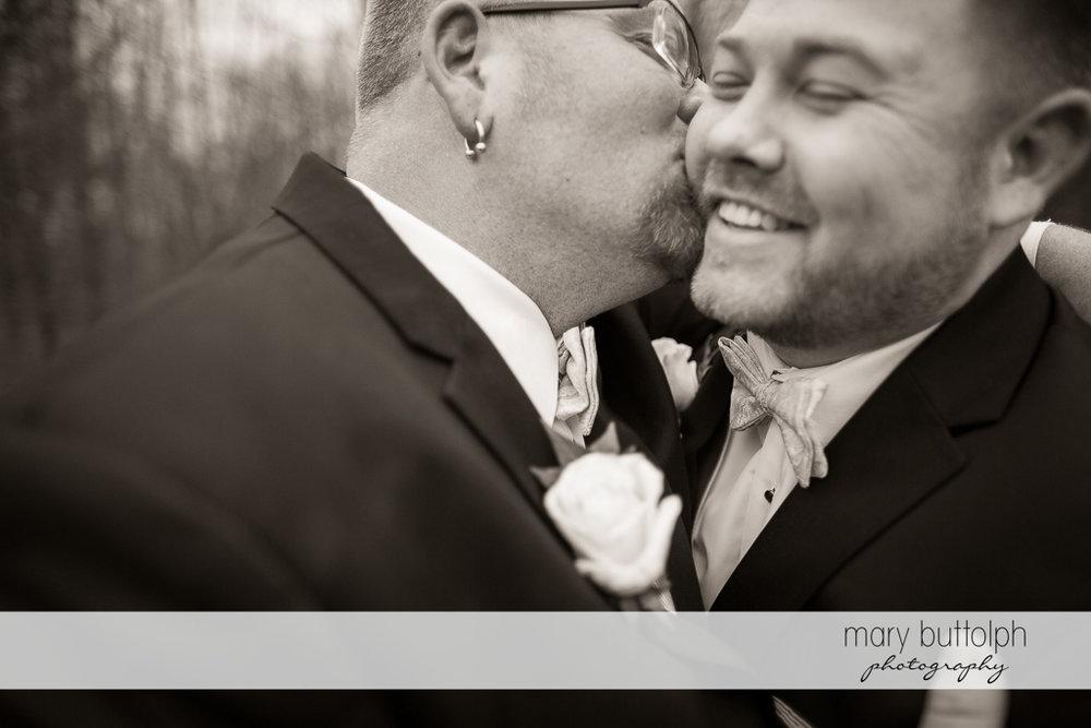 Groom hugs his partner at Arrowhead Lodge Wedding