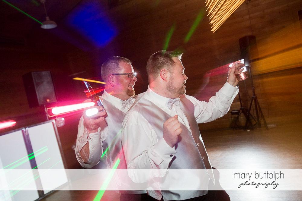 Same sex couple dance the night away at Arrowhead Lodge Wedding