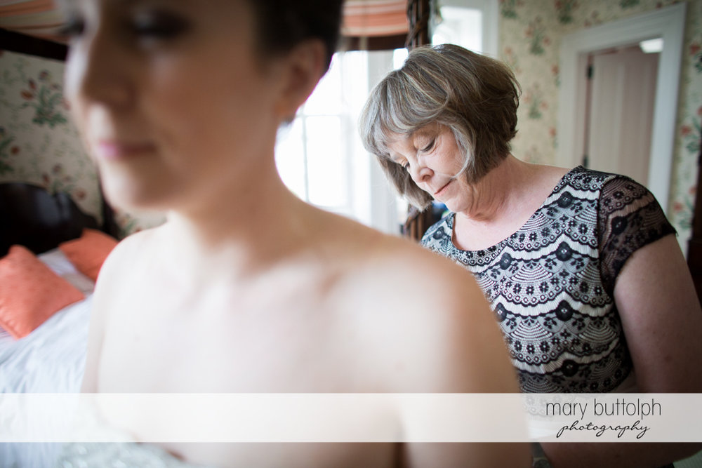 Bride and her mom prepare for the event at the Inns of Aurora Wedding