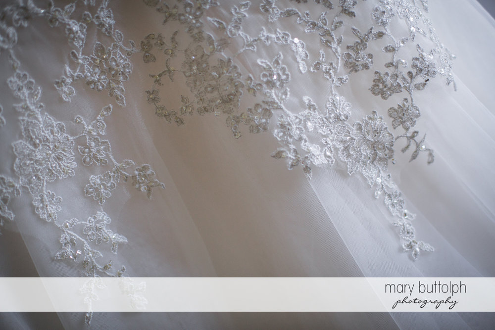 Detail of bride's wedding gown at the Inns of Aurora Wedding