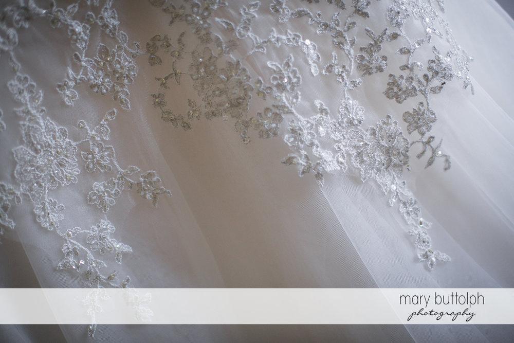 Detail of bride's wedding gown at the Inns of Aurora Wedding