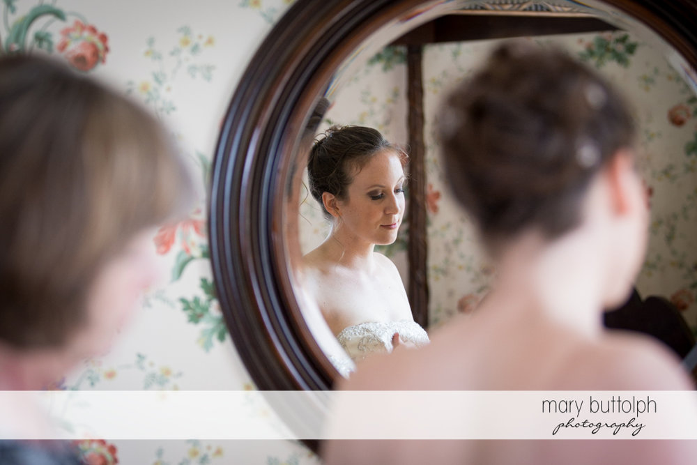 Bride's mirror image is seen in this shot at the Inns of Aurora Wedding